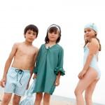 niños y niñas en bañador y boxer